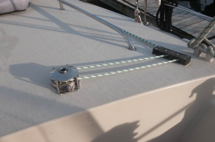 Line tender and turning blocks aft of the cockpit on the port side.